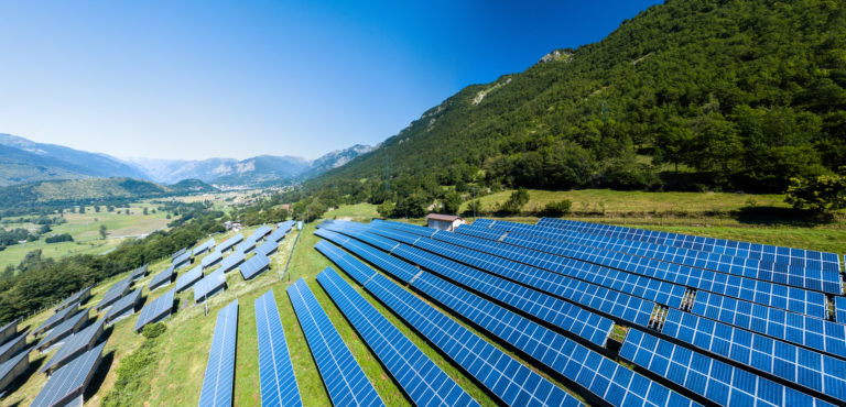 A solar farm on the side of mountain in Italy where they contribute to energy transition.